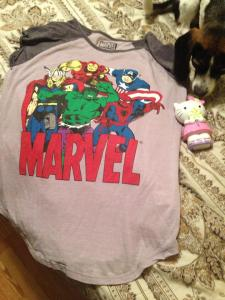 My AVengers T-Shirt and Hello Kitty Piggy Bank!! Yes my puppy photobombs!!